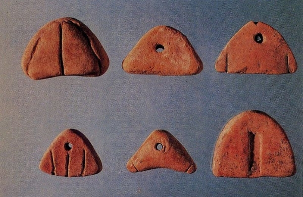Triangle tokens from Susa dating to  approximately 5500 B.P.