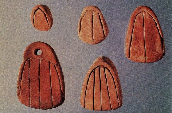 Incised parabollae tokens from Susa dating to approximately 5500 B.P.